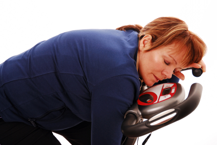 woman tired after exercise at gym